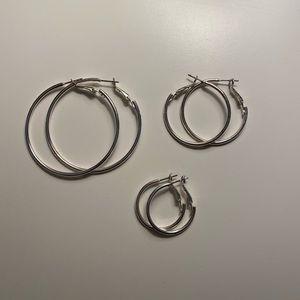 Set of three. Silver hoop earrings